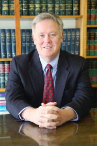 Tom Grant at desk